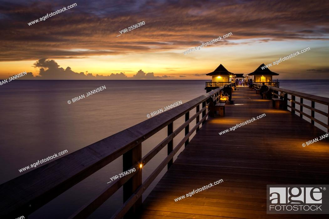 Stock Photo: Colorful sunset over the Naples Pier, Naples, Florida, USA.
