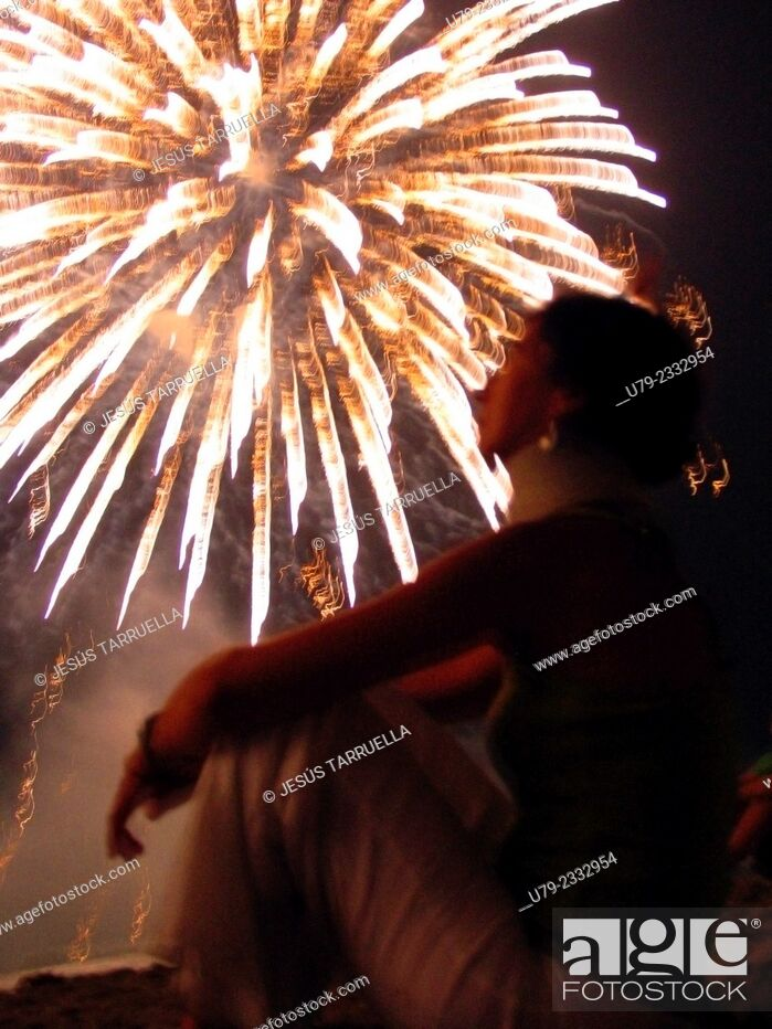 Stock Photo: Woman in display fireworks show.