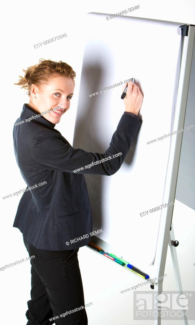 Stock Photo: businesswoman at whiteboard.