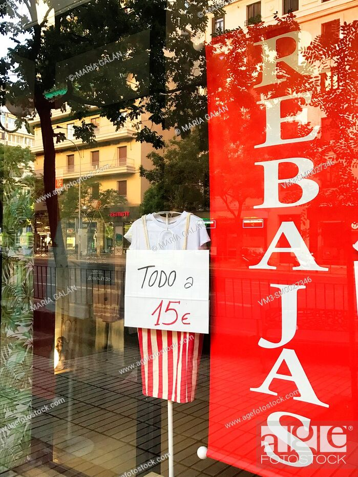 Stock Photo: Shop window during sales time. Madrid, Spain.