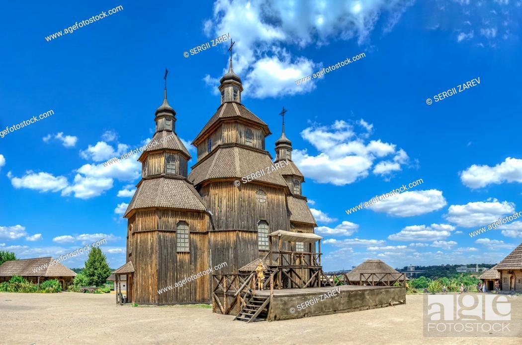Stock Photo: Zaporozhye, Ukraine 07. 20. 2020. Wooden church in the National Reserve Khortytsia in Zaporozhye, Ukraine, on a sunny summer day.