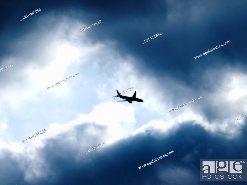 Stock Photo: Aeroplane in a stormy sky.
