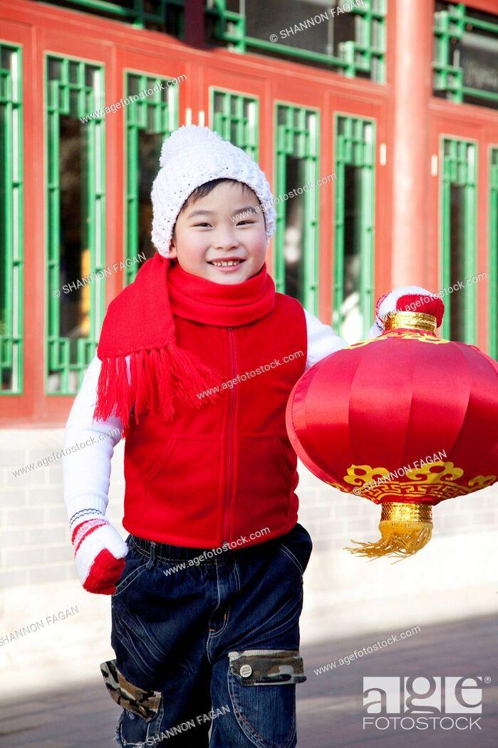 Stock Photo: Boy holding red lantern in Courtyard.
