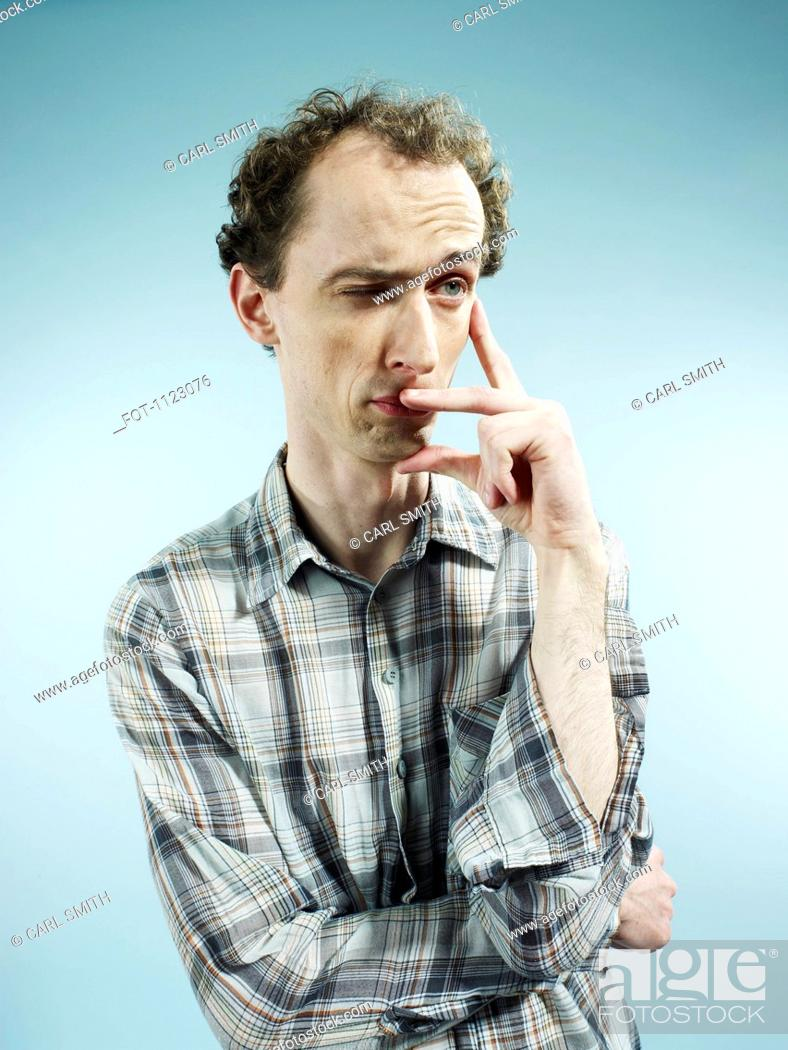 Stock Photo: A man with an expression of uncertainty, looking away.