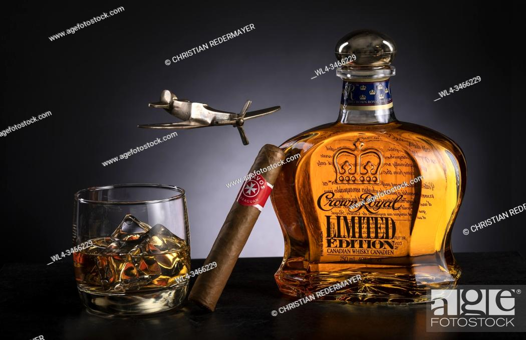 Stock Photo: Whiskey and cigar on wooden black background.