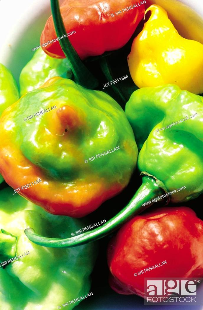 Stock Photo: Jamaica, Kingston market, red and green peppers.