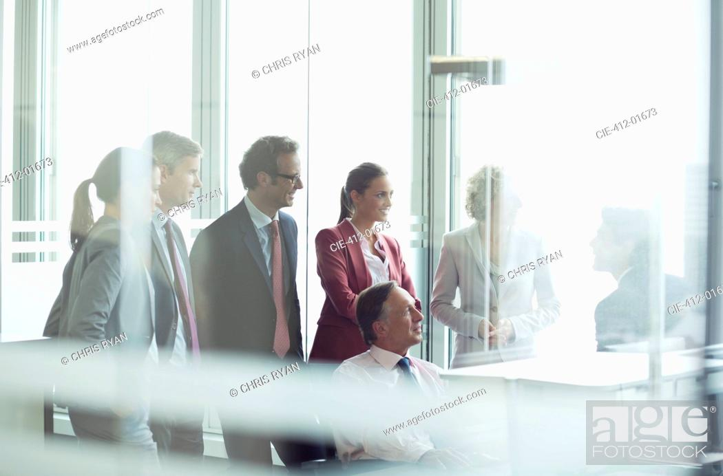 Stock Photo: Business people talking in meeting.