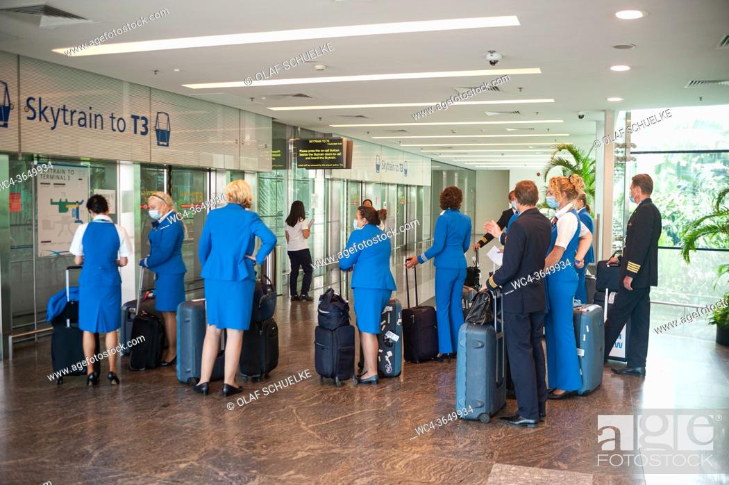 Stock Photo: Singapore, Republic of Singapore, Asia - Pilots and flight attendants of the Dutch airline KLM are seen upon their arrival at Changi Airport's Terminal 1.