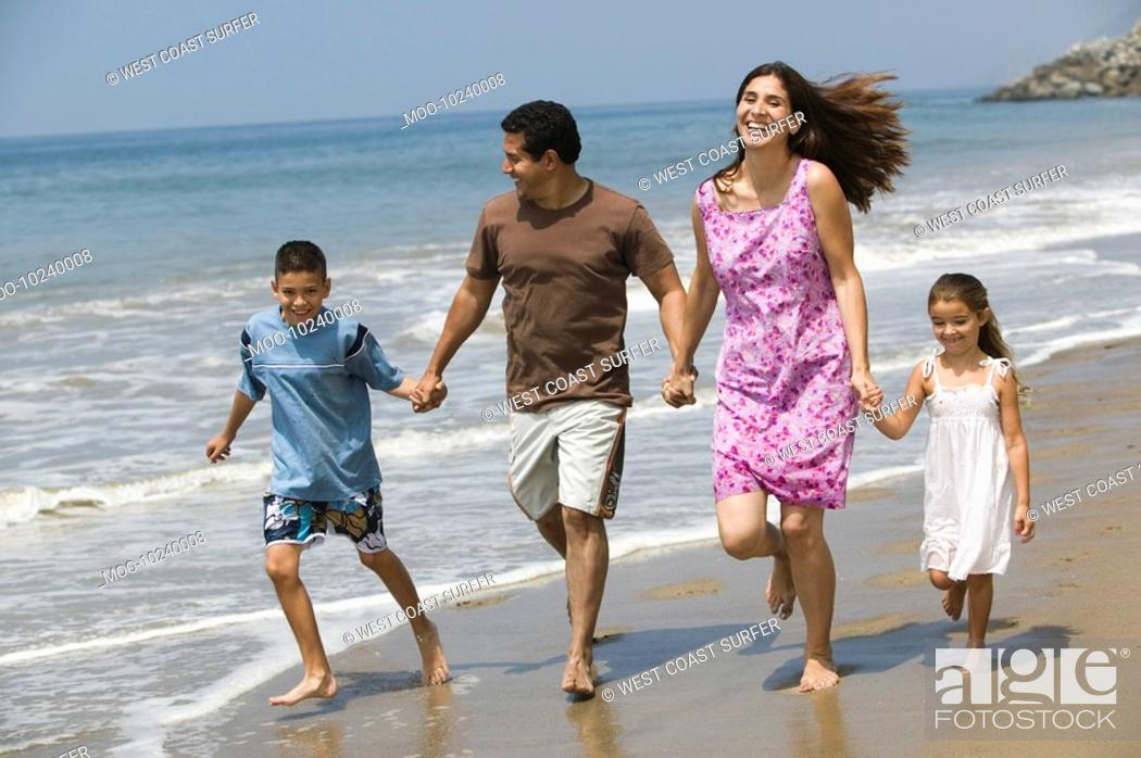 Stock Photo: Family Walking on the Beach.