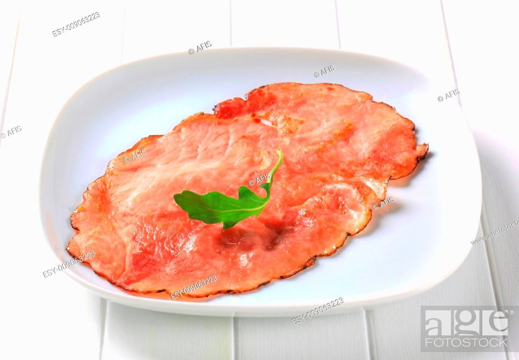 Stock Photo: Thin slice of smoked ham.