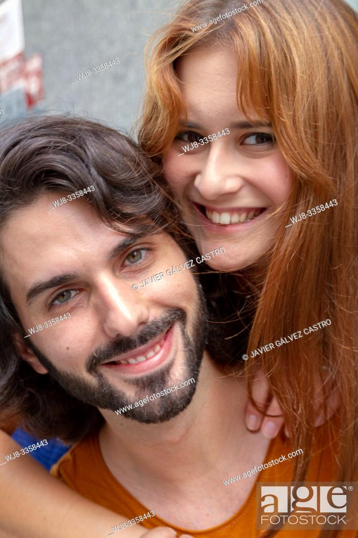 Stock Photo: Portraits of a couple Young, complicit and smiling around the city.