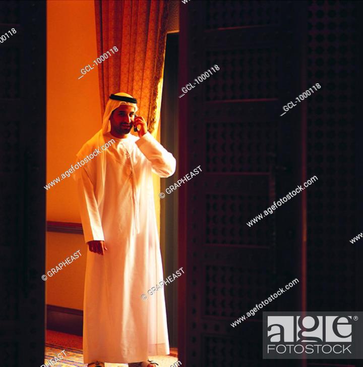 Stock Photo: Arab businessman using cell phone.