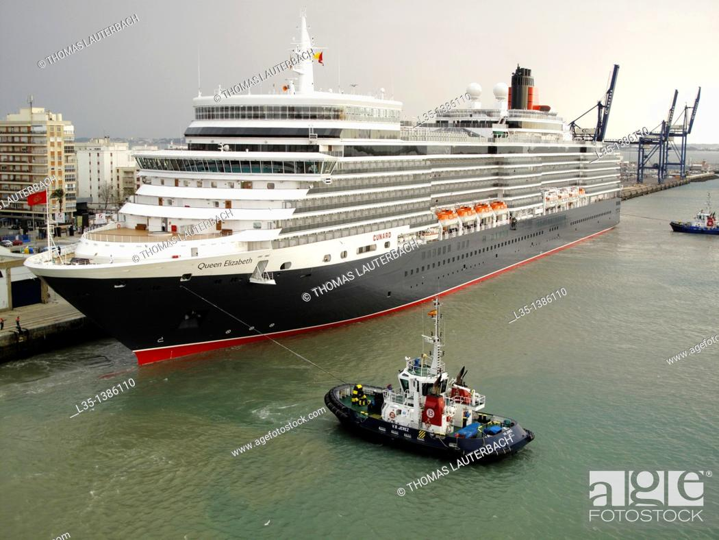 Stock Photo: Cruise liner Queen Elizabeth is towed into the port of Cadiz, Spain.