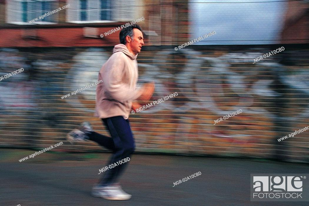 Stock Photo: elderly man jogging.