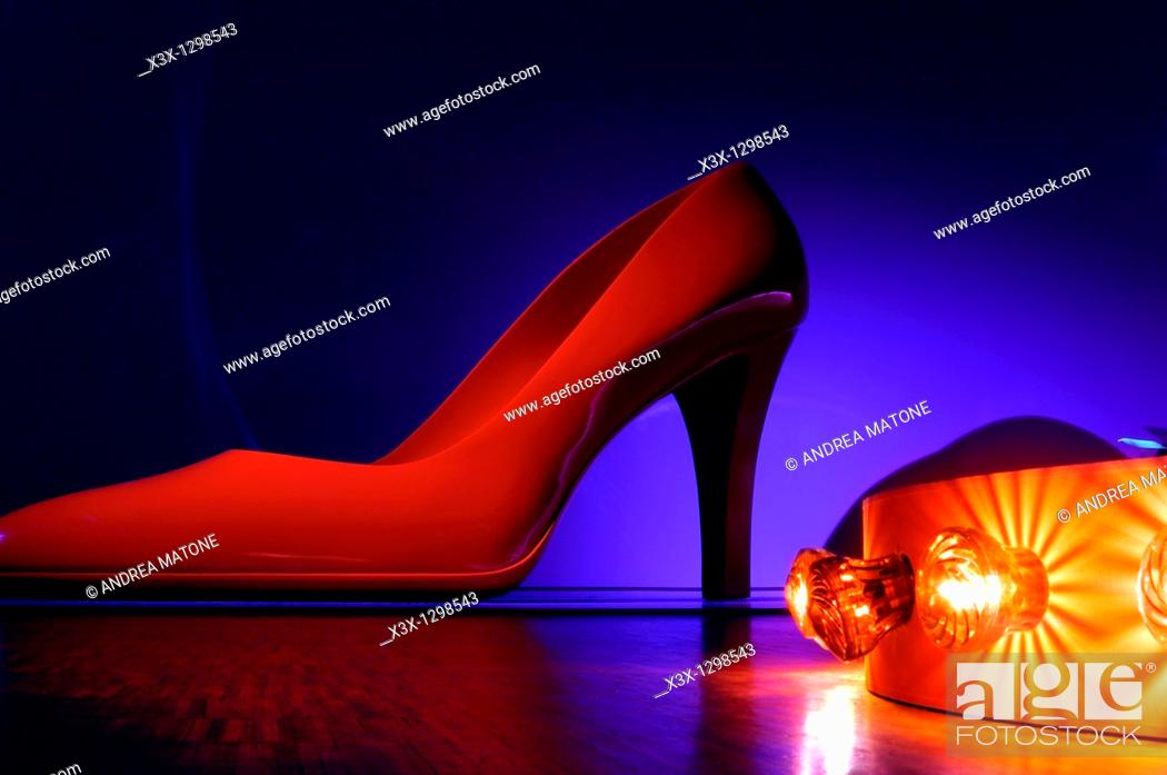 Stock Photo: Red high heel lady shoe in Neon.
