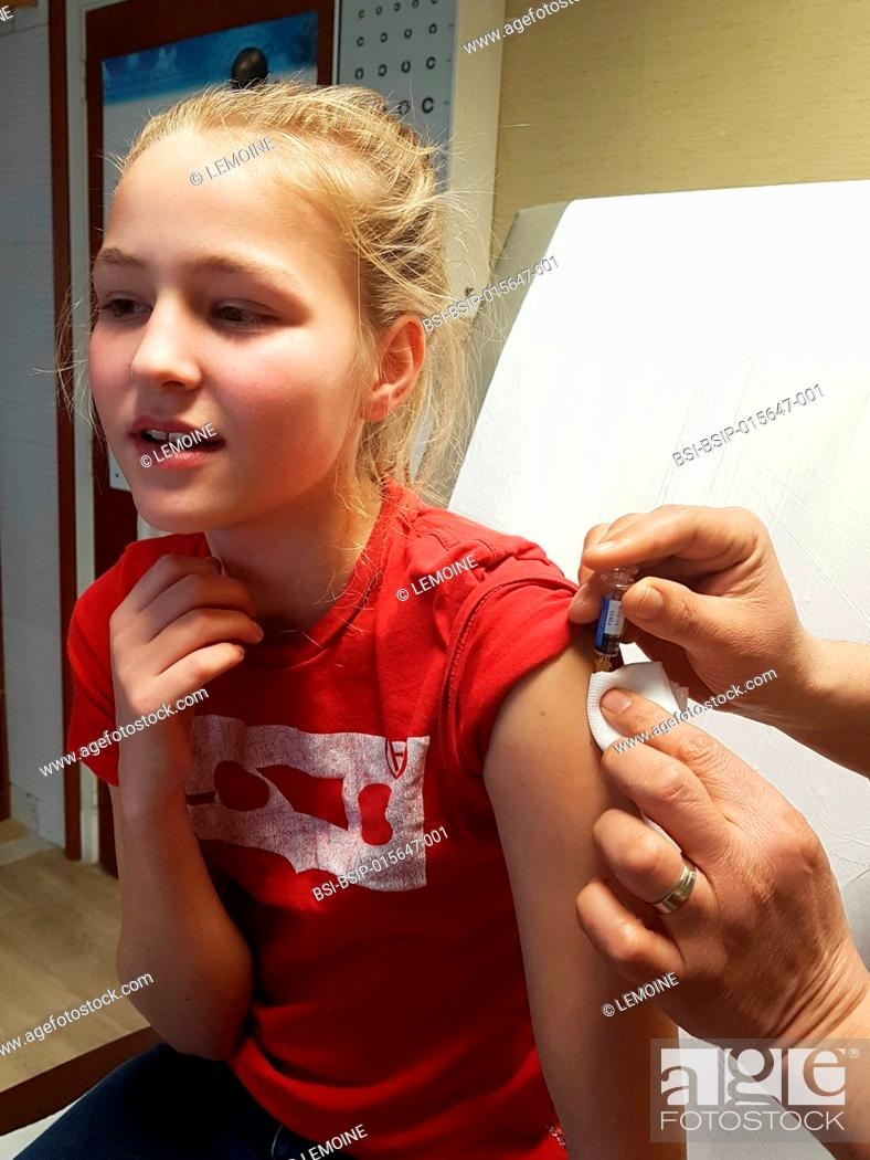Stock Photo: Vaccinating a teenager with Repevax (vaccination for diphtheria, polio and pertussis).