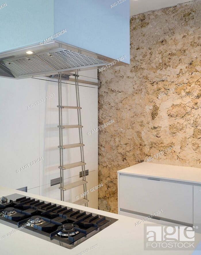 Stock Photo: Kitchen with exposed stone wall and ladder.