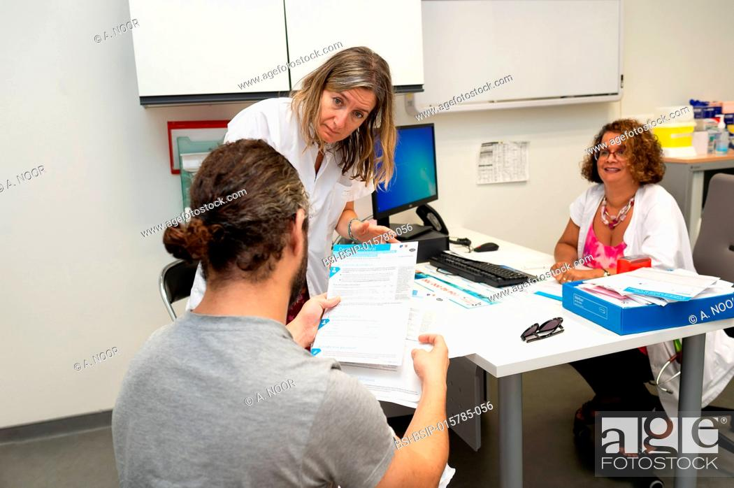 Stock Photo: Consultation with a patient who is under 40 and deaf, suffering from Usher syndrome, a genetic disease associating deafness and chorioretinitis with vestibular.