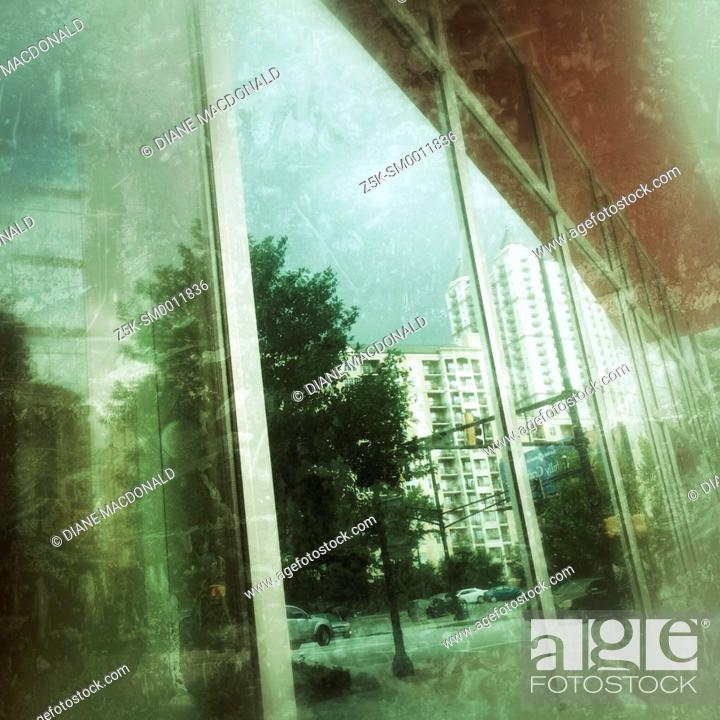 Stock Photo: Reflections of Peachtree Street, Atlanta, Georgia in a window.