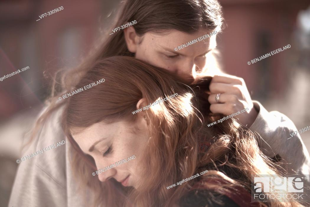 Stock Photo: man smelling hairs of woman, woman resting on man, closeness, affectionate couple, sensitiveness, in Berlin, Germany.