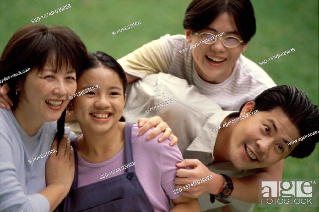 Stock Photo: Parents with their son and daughter.