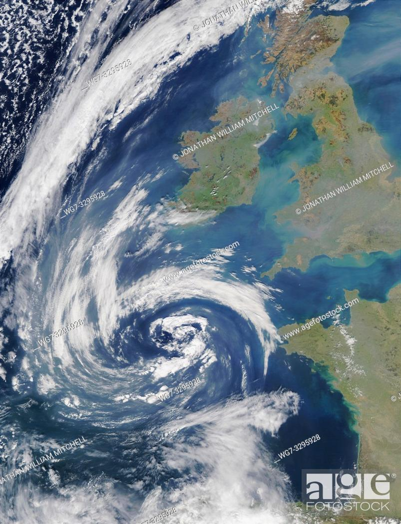 Stock Photo: EARTH United Kingdom -- 23 Mar 2003 -- Pollution and smoke get caught up in a swirl of clouds off on the coasts of Spain, France, Ireland.