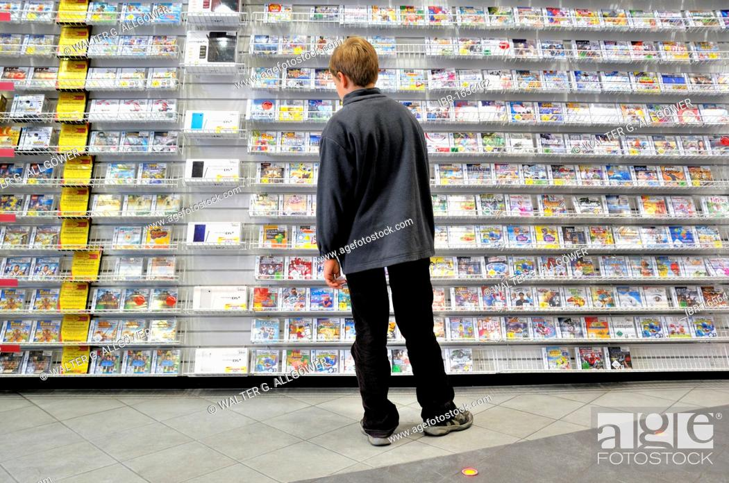 Ten-year-old boy boy in a store with a large selection of