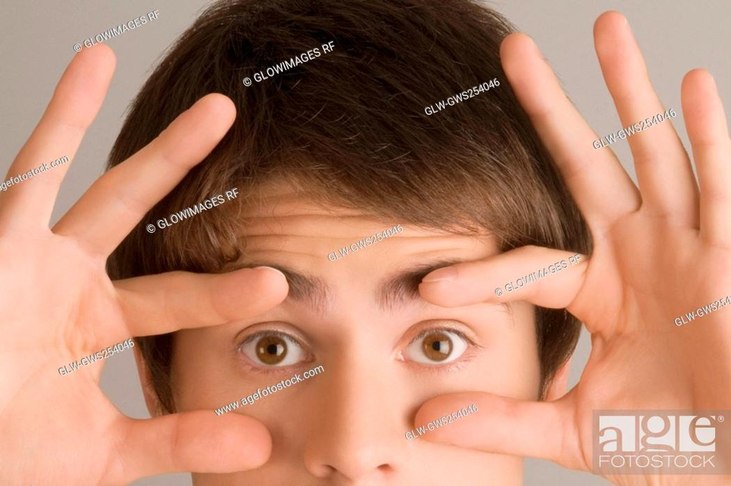 Stock Photo: Close-up of a young man staring.