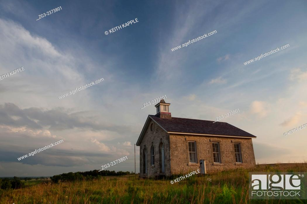 Stock Photo: Abandoned Scholl house at sunset in Kansas.