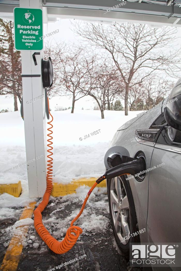 Stock Photo: Detroit, Michigan - A Chevrolet Volt electric car charging outside the General Motors Detroit-Hamtramck Assembly Plant, where the Volt is manufactured.