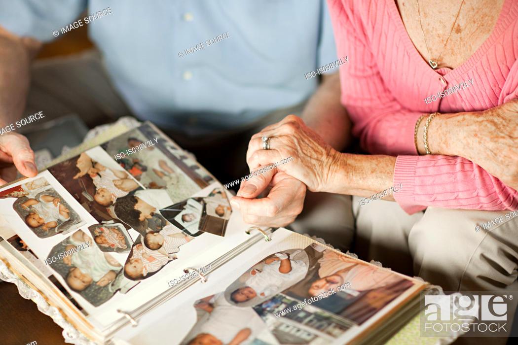 Stock Photo: Senior couple with at family album.