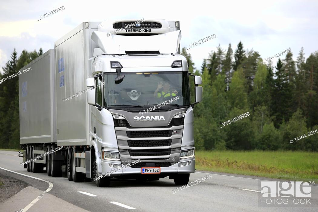 Stock Photo: Uurainen, Finland - August 25, 2018: Silver Next generation Scania R500 of Mattila pulls Thermo King refrigerated trailer along highway in the summer.