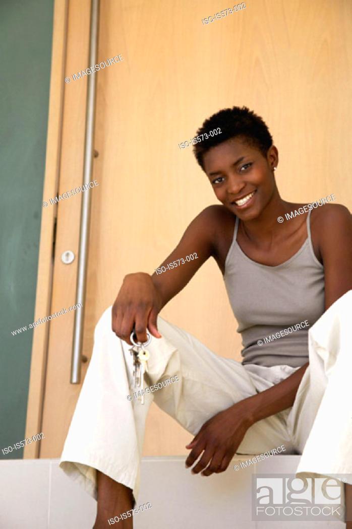 Stock Photo: Woman sitting on step.