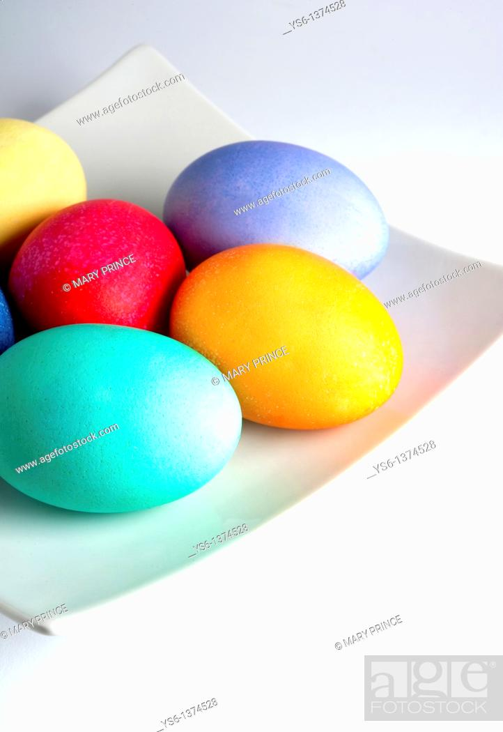 Stock Photo: Colored Easter Eggs on a White Plate.