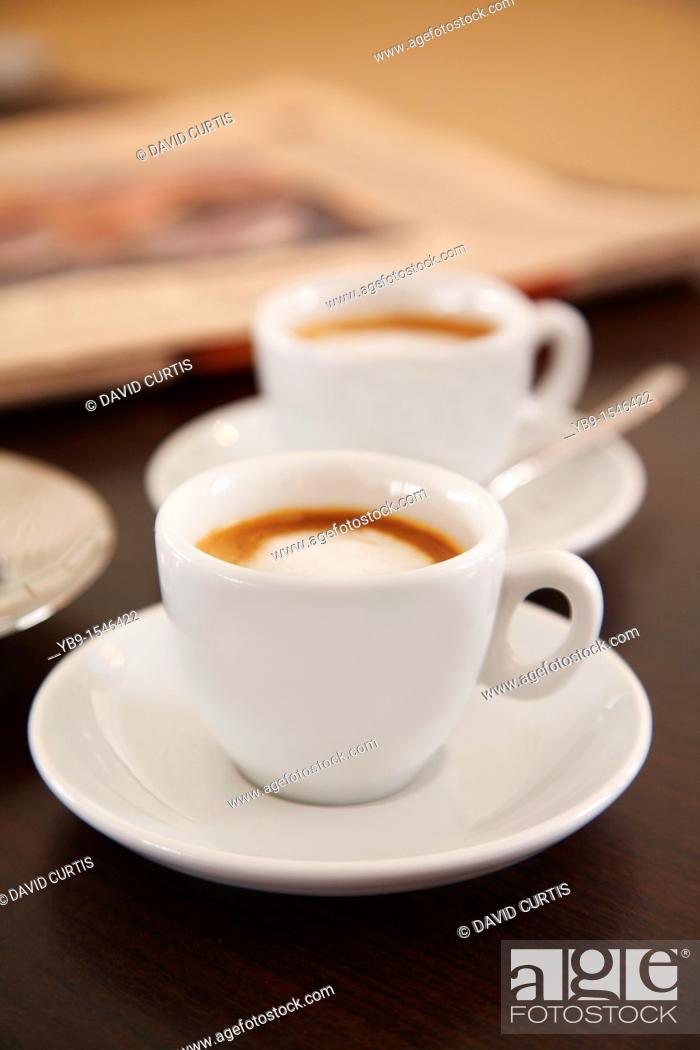 Stock Photo: Two cups of espresso coffee on a table.