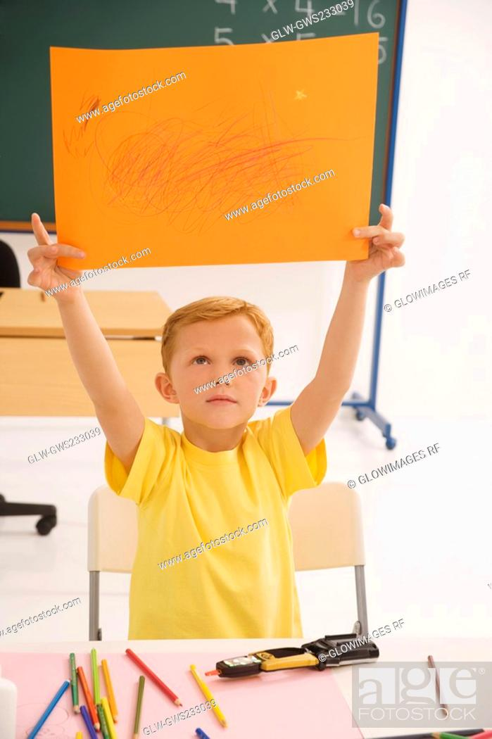 Stock Photo: Schoolboy showing his drawing.