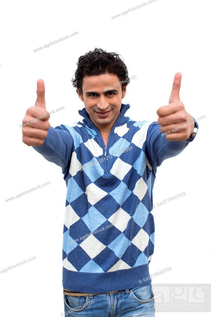 Stock Photo: Portrait of a man showing thumbs up sign.