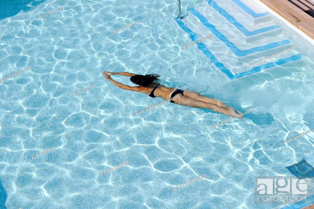 Stock Photo: Young girl swimm in hotel front of the ocean.