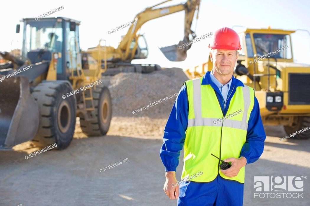 Stock Photo: Construction worker standing on construction site.
