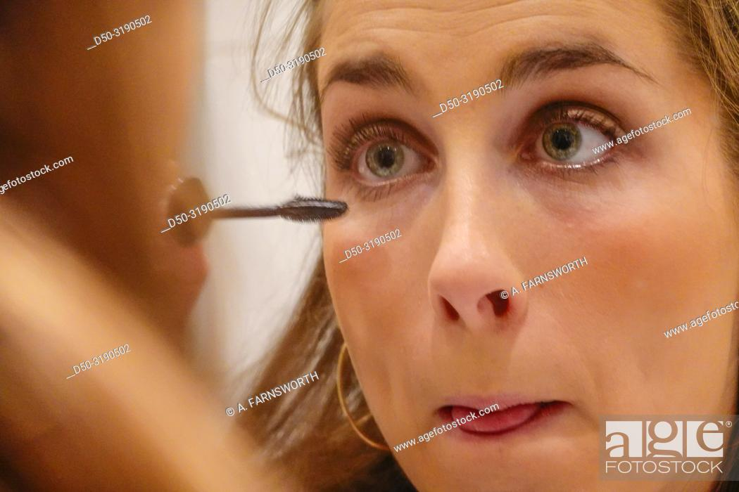 Stock Photo: Stockholm, Sweden A 24 year old woman puts makeup on before going out on a Saturday night.