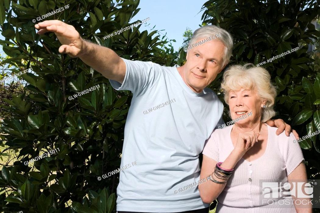 Stock Photo: Senior couple standing in a garden.