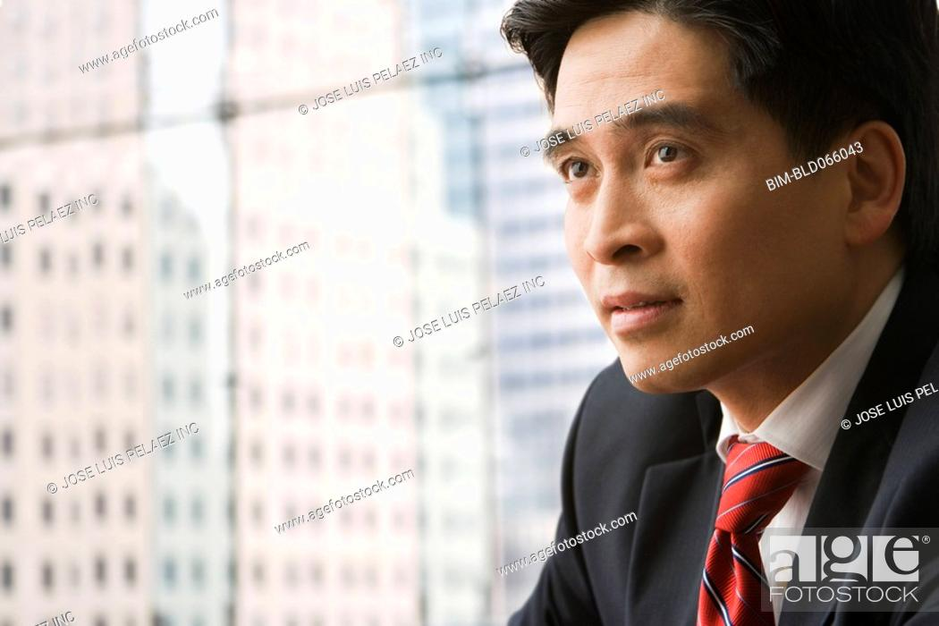 Stock Photo: Serious Chinese businessman.
