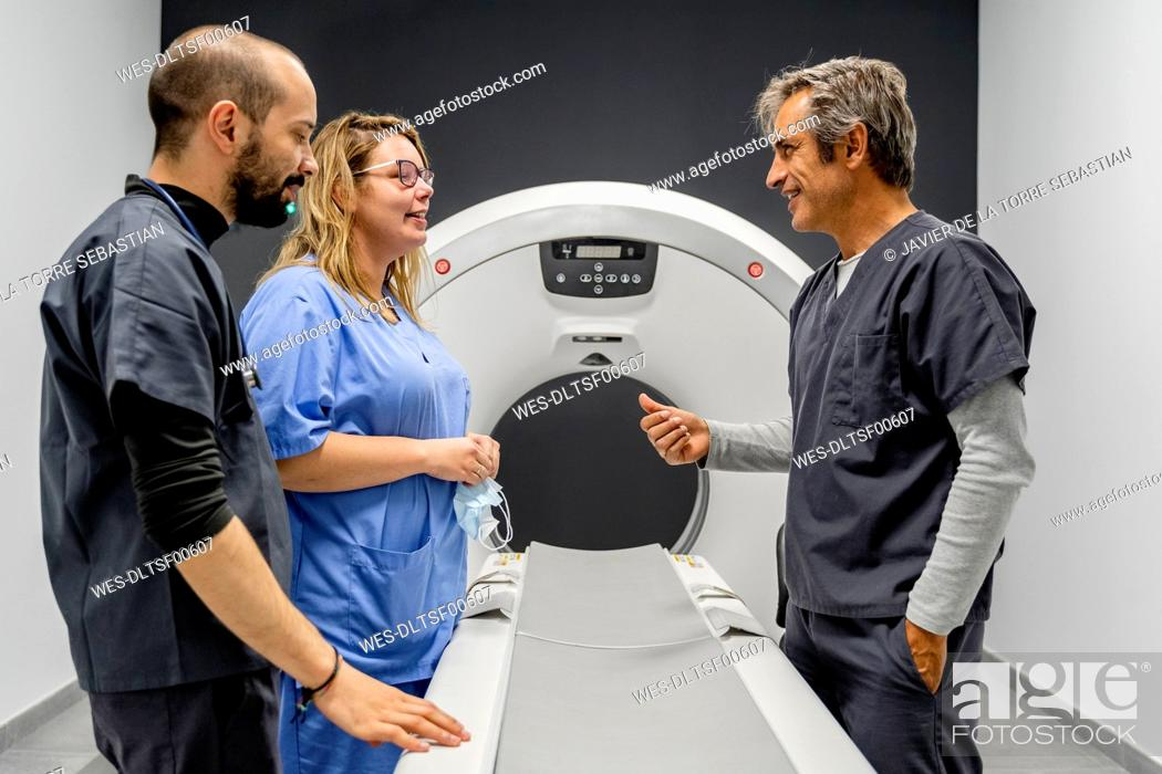 Stock Photo: Smiling team talking in veterinary clinic.