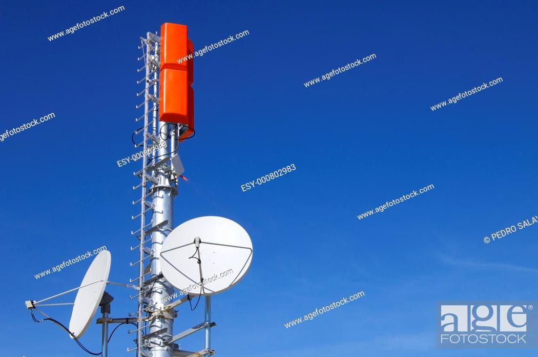Stock Photo: closeup of a television and radio repeater with a clear blue sky.