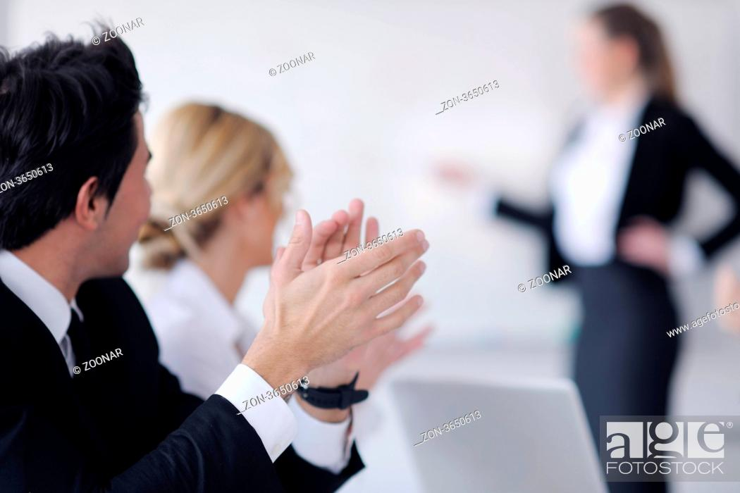Stock Photo: business people team at a meeting in a light and modern office environment.