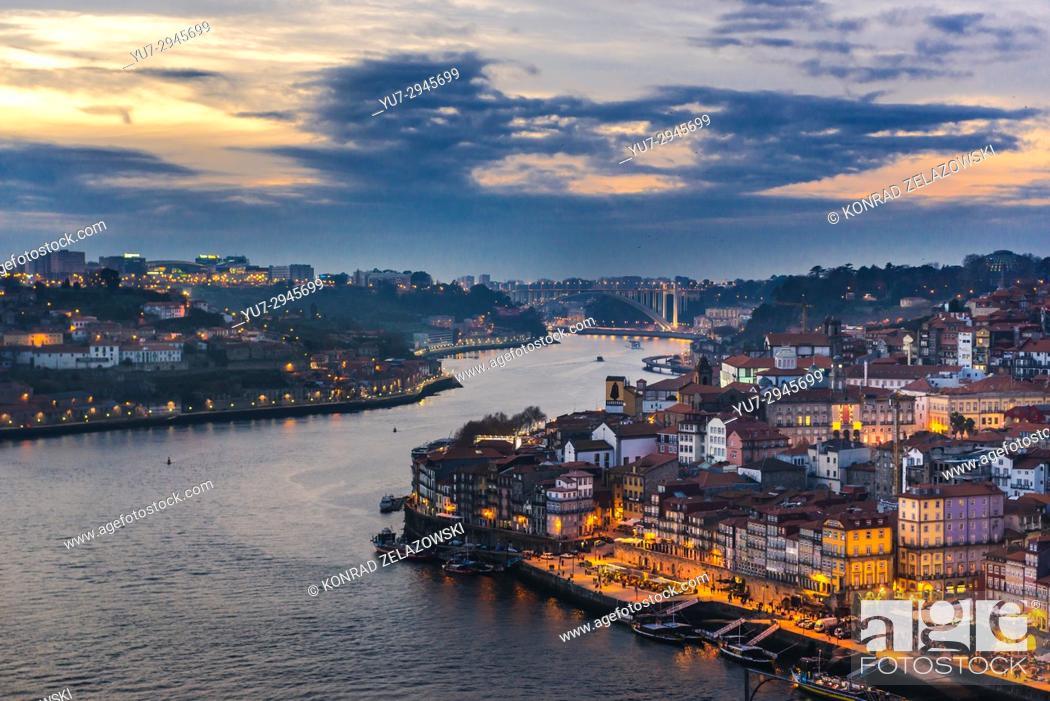 Stock Photo: Sunset over Douro River and cities of Porto (right) and Vila Nova de Gaia, Portugal.