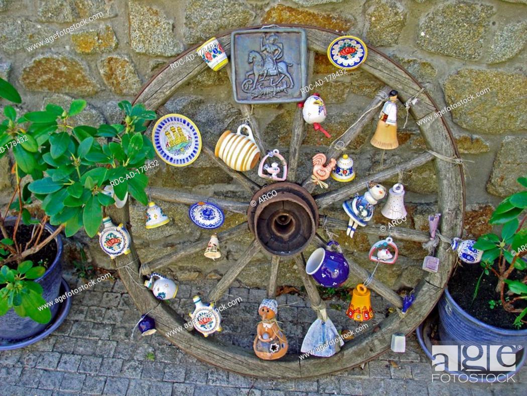 Stock Photo: Cart of wheel with souvenirs, Bratislava Castle, Bratislava, Slovakia.