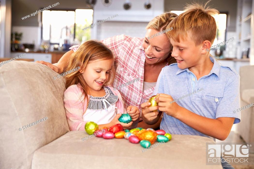 Stock Photo: Mother celebrating Easter at home with kids.