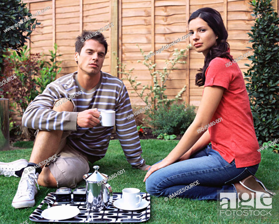 Stock Photo: Young couple having coffee in the garden.