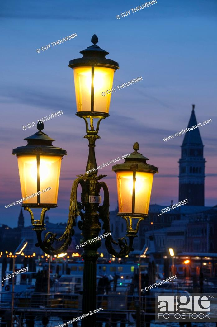 Stock Photo: Lit lamposts on San Marco basin, and campanile, San Marco, Venice, Italy.